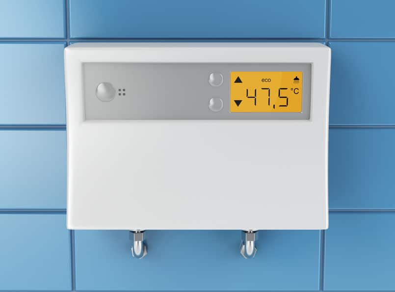 Instantaneous-Hot-Water-Heater-attached-on-blue-tiled-wall