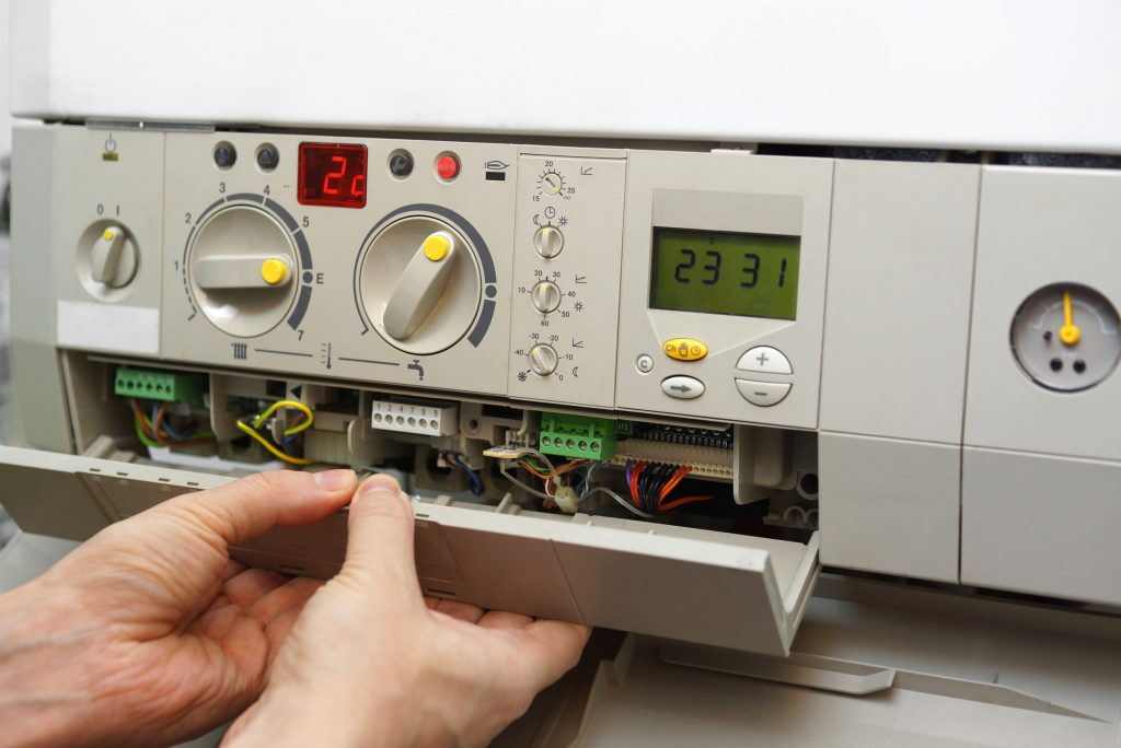 gas-furnace-repair-technician-working-on-the-furnace-control-panel-1024x684