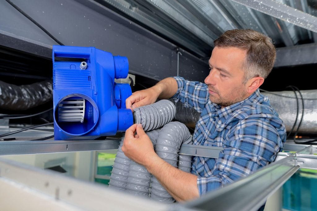 heating and cooling contractor in Seattle installing air conditioning