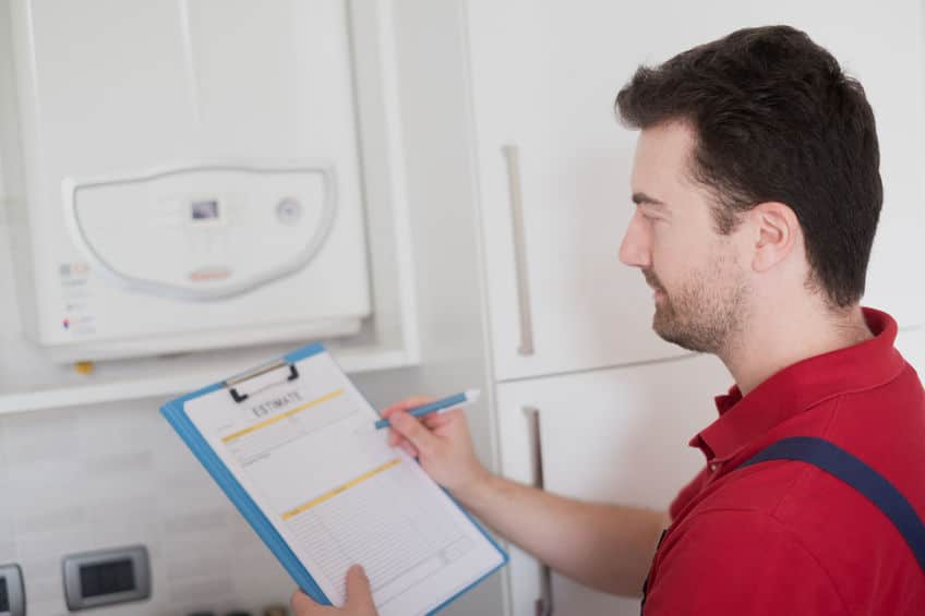 hvac-technician-checking-a-hot-water-heater-maintenance-checklist
