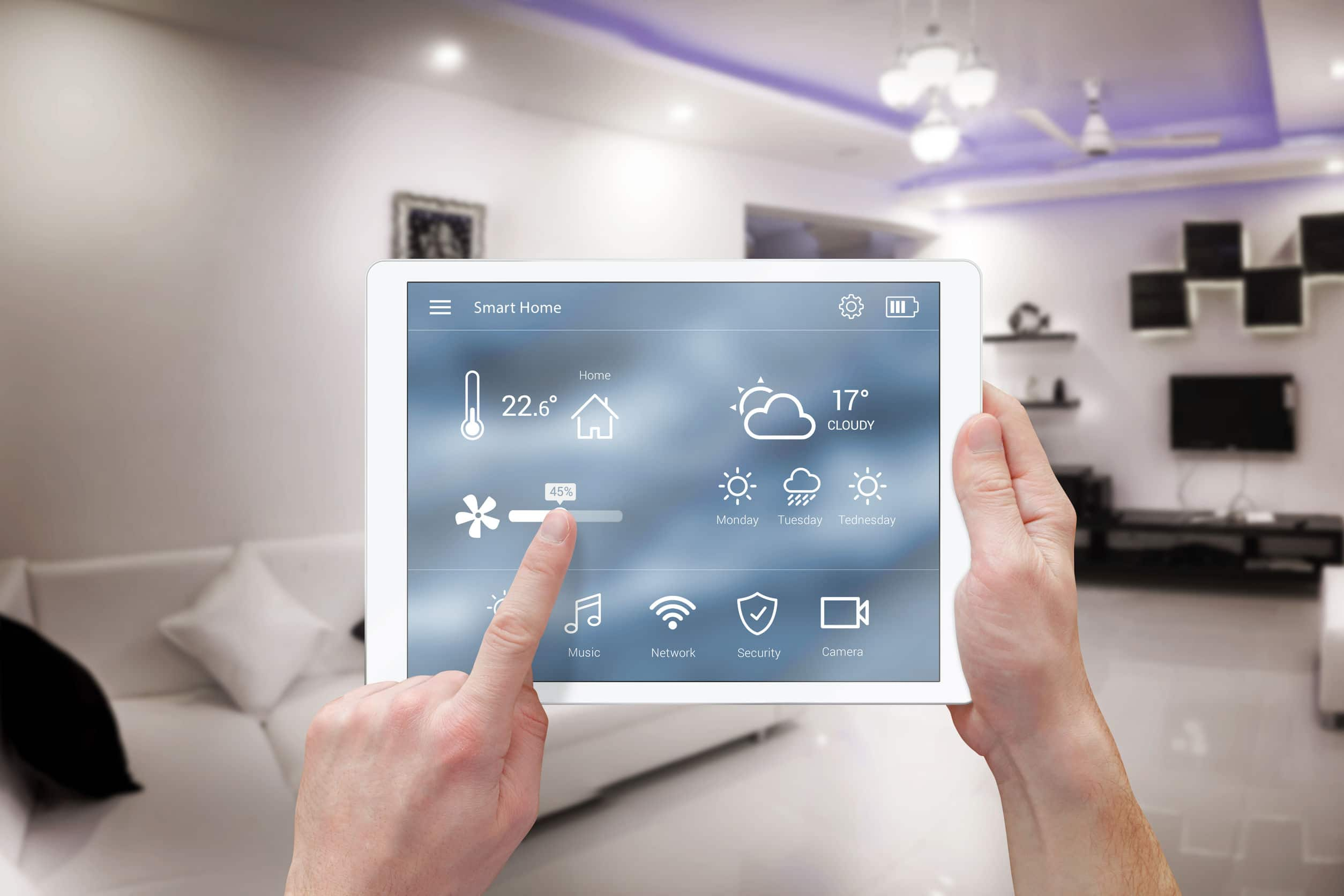 smart remote home control system app in sync with a smart thermostat to control room temperature.