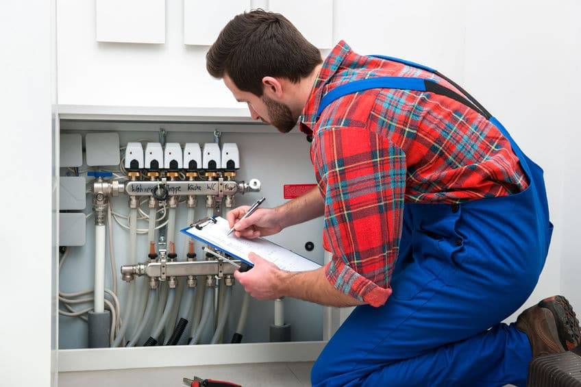 technician-conducting-check-up-as-part-of-hvac-winter-maintenance