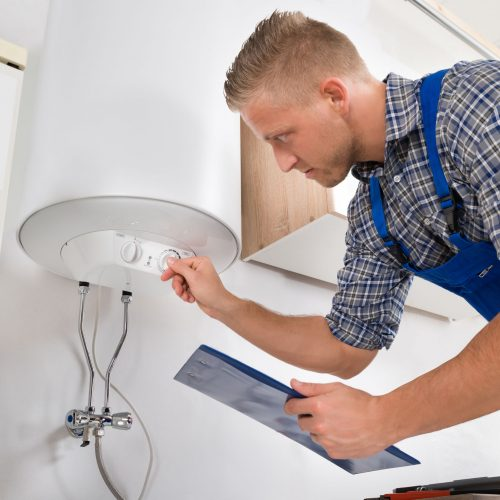 technician-inspecting-the-hot-water-heater-control-panel-500x500